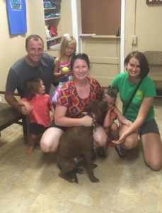 Olaf is going to have a great time with his new family.  He is already getting started with puppy kisses in this photo!